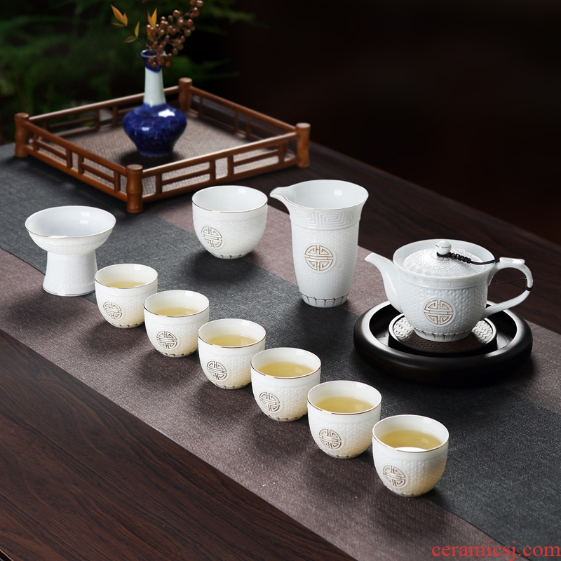 Red the jingdezhen ceramic hand - made relief the see colour white porcelain kung fu tea set household contracted with a complete set of tea
