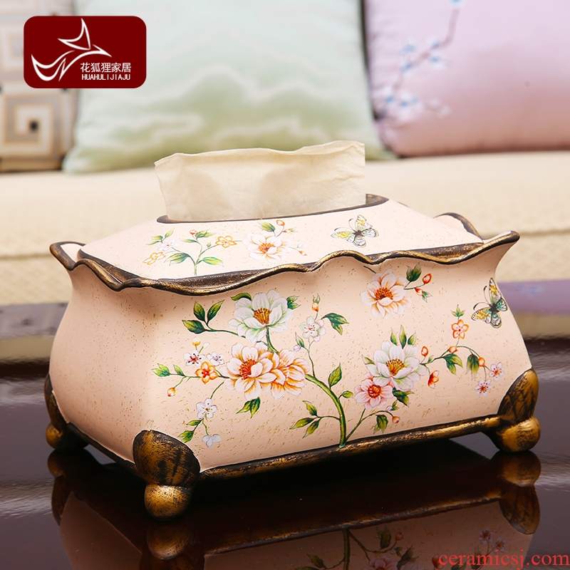 American pastoral ceramic tissue box European sitting room adornment is placed between example creative painting of flowers and tea table smoke box