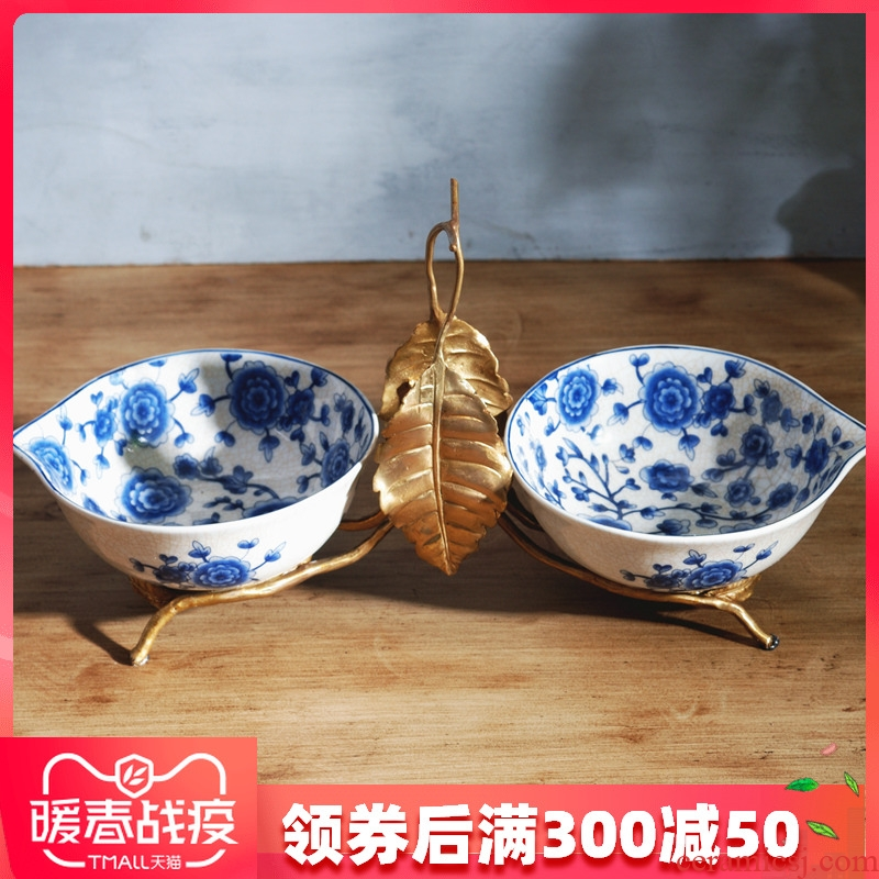 The New Chinese blue and white porcelain with copper fruit bowl dried fruit bowl sitting room home furnishing articles fruit dish of American creative move ceramics