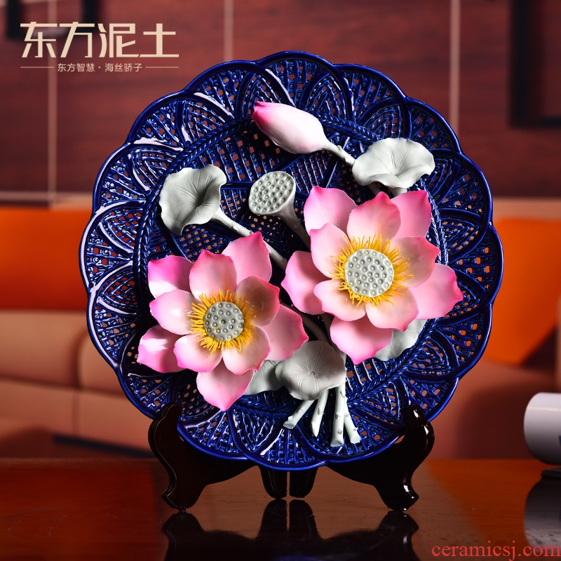 Oriental soil creative ceramic flower hang dish furnishing articles of Chinese style living room decoration plate of dehua white porcelain arts and crafts