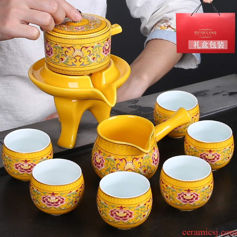 Gold colored enamel of a complete set of automatic tea set lazy hot stone mill ceramics kung fu tea tea gift set is installed