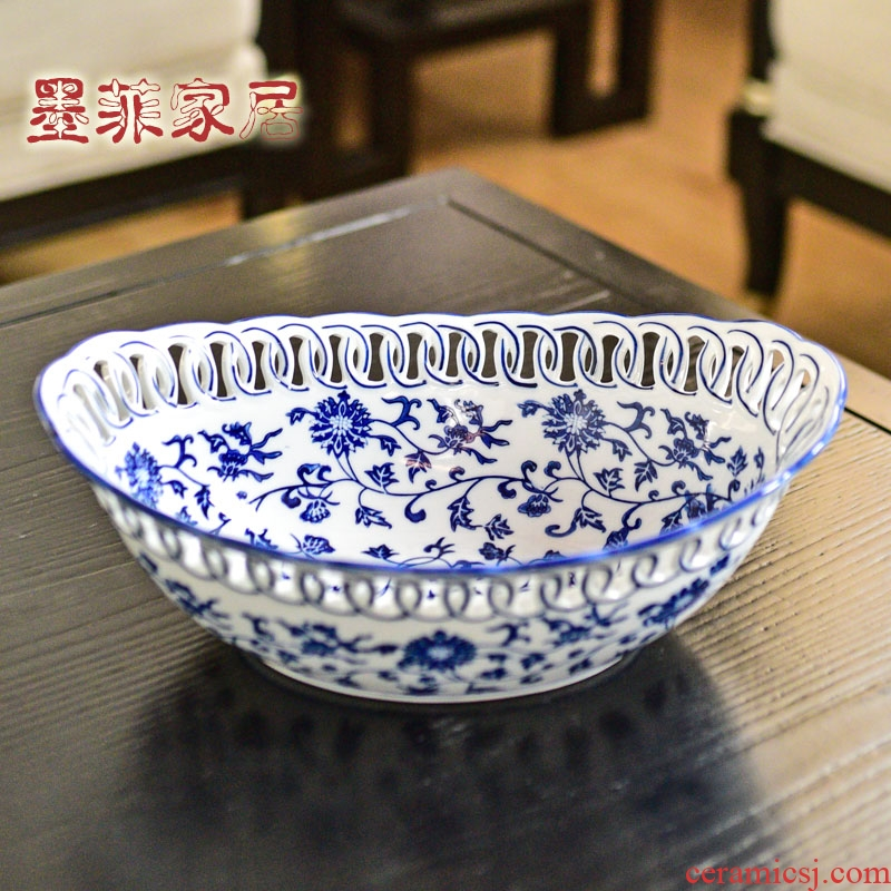 New Chinese style restoring ancient ways of jingdezhen blue and white porcelain ceramic hollow out fruit bowl dried fruit tray table sitting room adornment is placed
