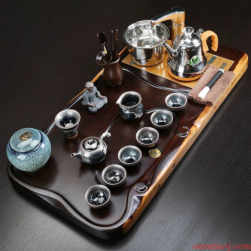 A complete set of tea service suit household contracted solid wood tea tray tea purple sand automatic kung fu tea tea sea