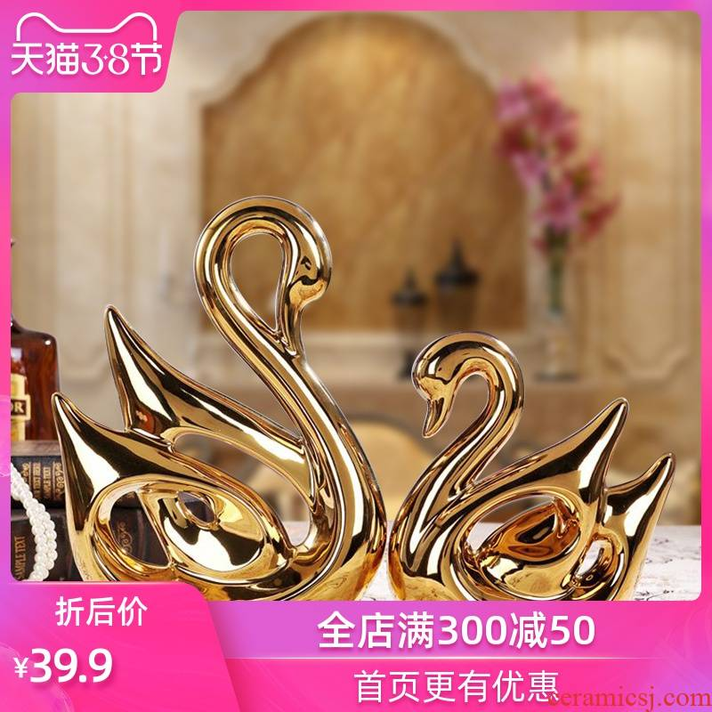 Creative ceramic handicraft wedding gift for the sitting room TV ark, furnishing articles of modern home decoration electroplating swans
