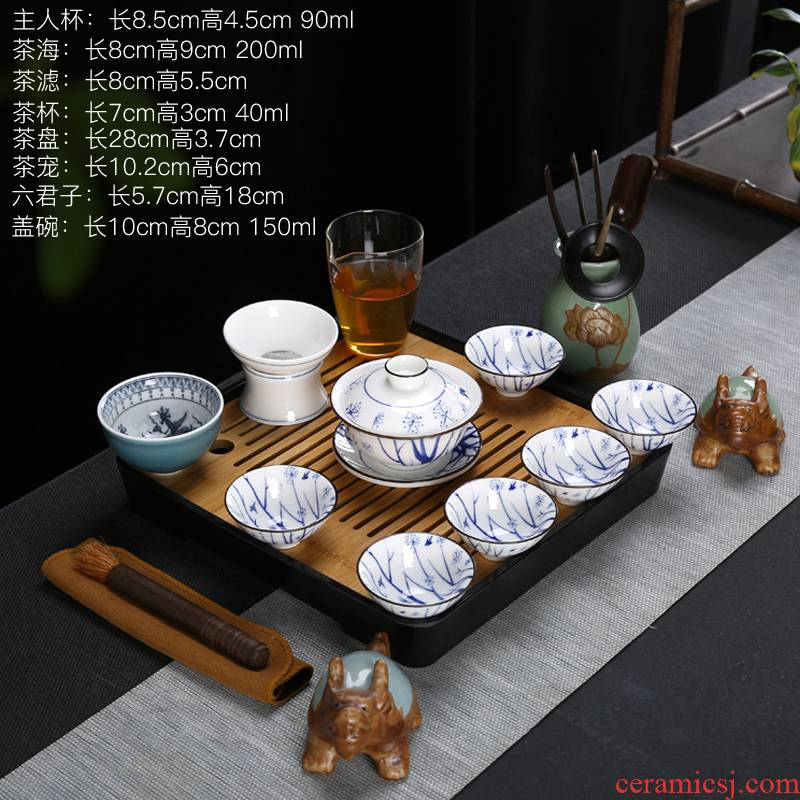 Travel pad printing white porcelain of a complete set of kung fu tea set suet jade porcelain ceramic cups lid to use bamboo tea tray