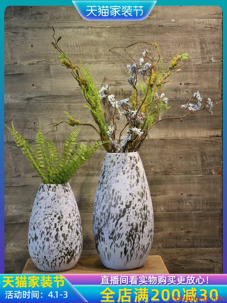 Jingdezhen coarse pottery dated mesa vase teahouse adornment is placed between example simulation flowers floral arrangements