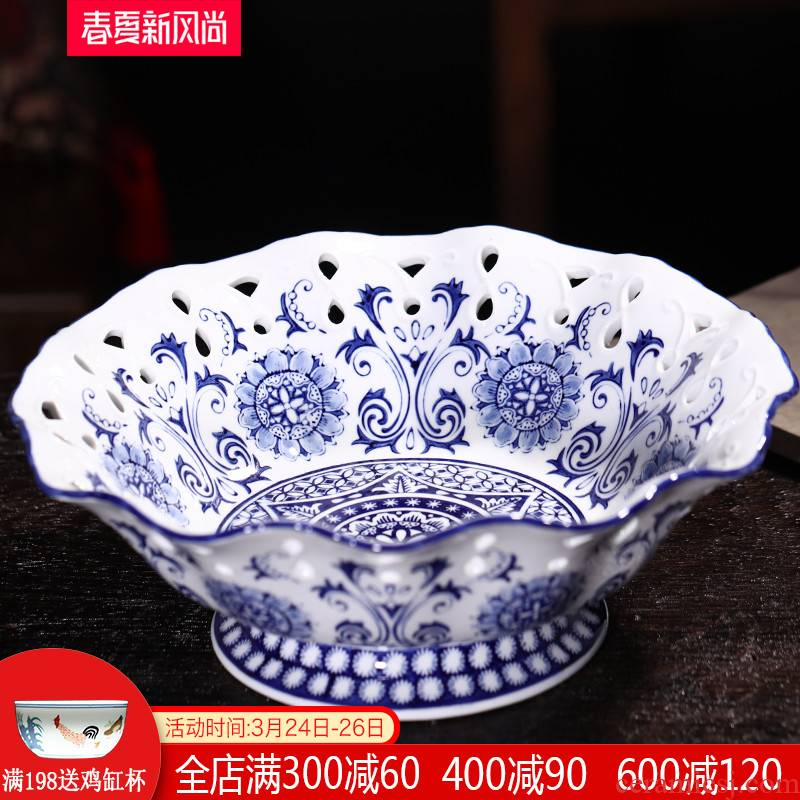 Blue and white hollow ceramic high fruit bowl jingdezhen porcelain basket candy plate of new Chinese style of modern home decoration
