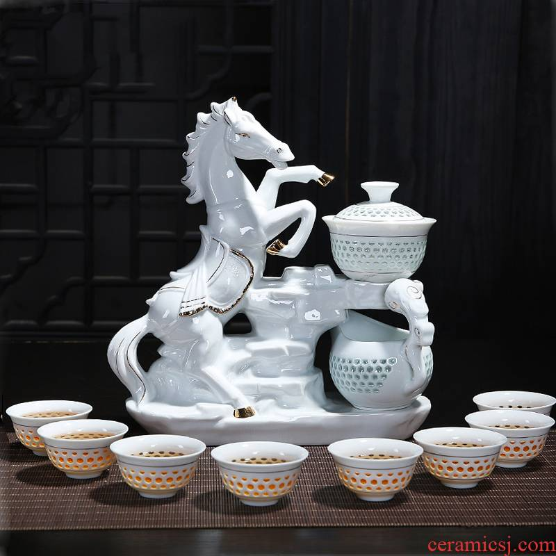 Creative blue and white porcelain ceramic kung fu tea sets with ceramic and exquisite hollow out of a complete set of automatic tea set