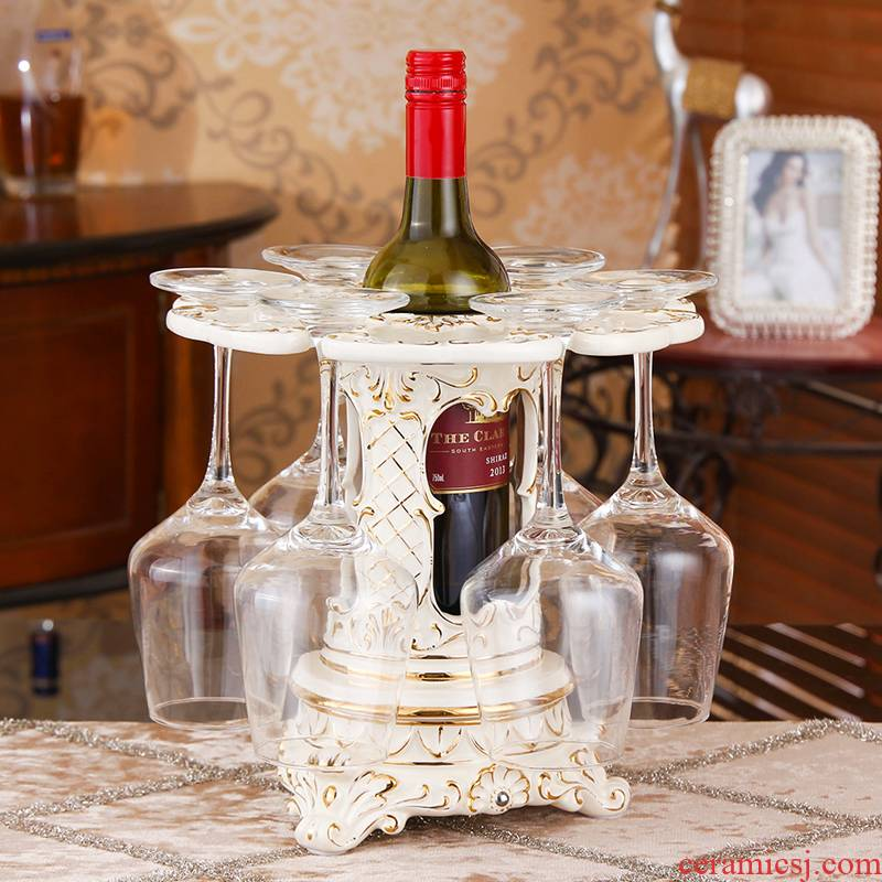 European cup upside down household rotating ceramic goblet aircraft creative wine sitting room adornment is placed red wine rack
