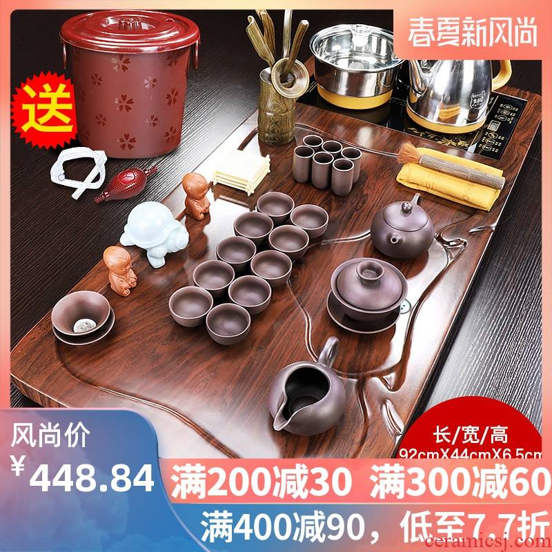 The teapot tea tray was domestic tea set automatic purple sand pottery and porcelain of a complete set of kung fu solid wood tea tea cups
