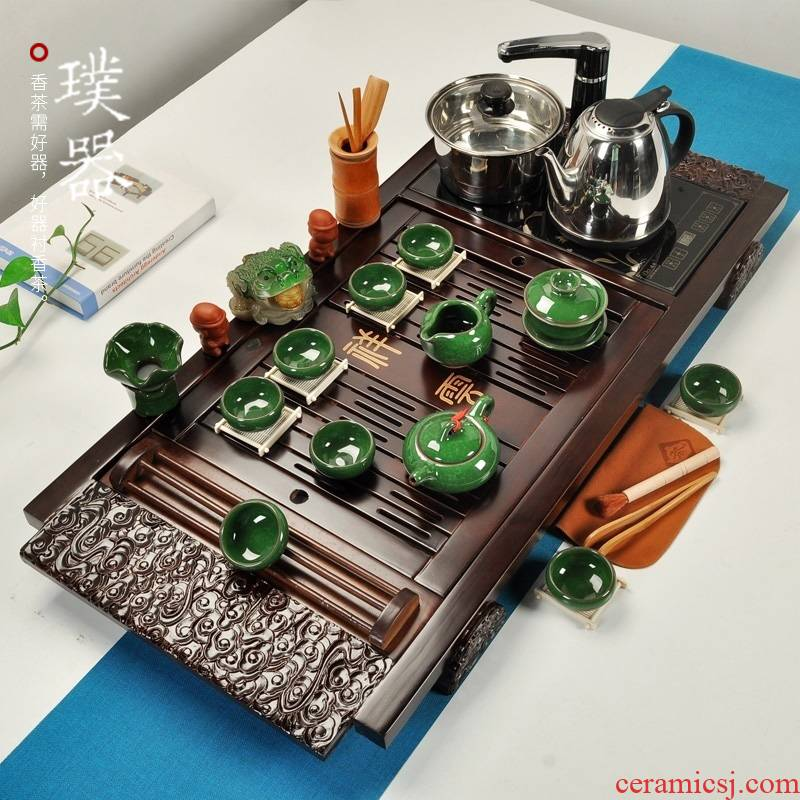 Brand to implement four unity of household electric heating furnace solid wood tea tray was set a complete set of violet arenaceous kung fu tea tea set drainage type