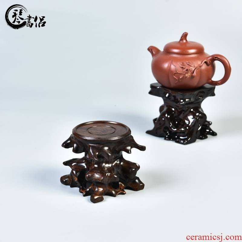 The teapot base hand - carved monolith ebony it planter base solid wood round stone base can be excavated