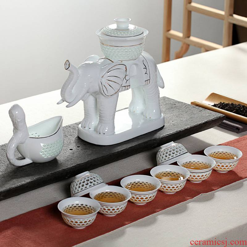 Xin arts edge of a complete set of automatic and exquisite hollow ceramic kung fu tea set suit creative hot lazy teapot