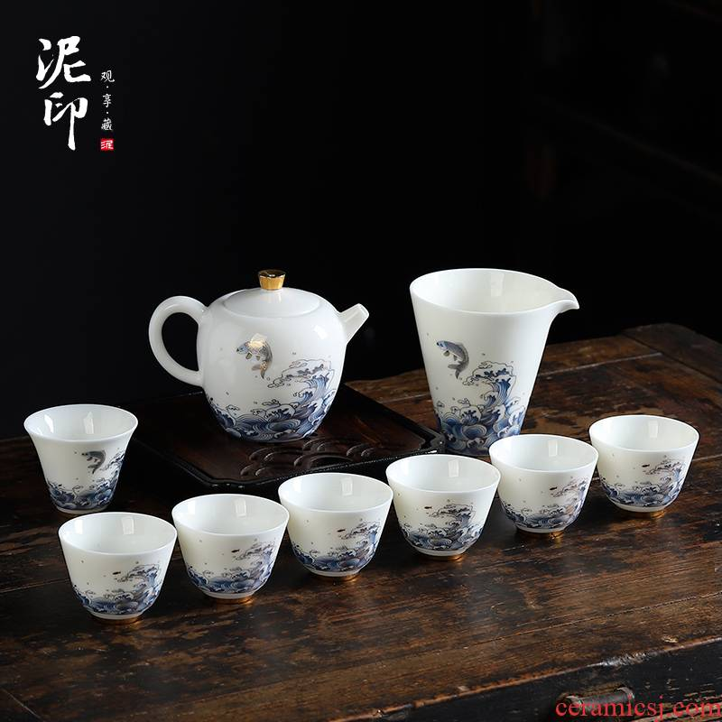 Mud printed white porcelain tea set suit small household kung fu tea cups dehua white porcelain teapot. A complete set of gift box office
