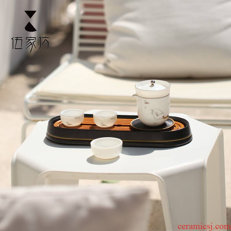 The Wu family travel lane ceramic suit Japanese crack cup creative portable receive small package kung fu tea set home