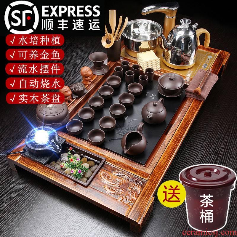 Hui shi, a complete set of automatic water tea set household kung fu solid wood tea tray zisha teapot tea on sale