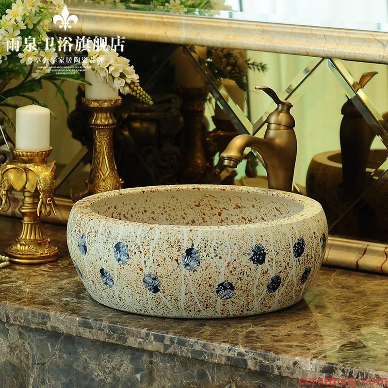 Jingdezhen ceramic art rain spring on the stage basin round basin carved antique basin bathroom sink in the kitchen