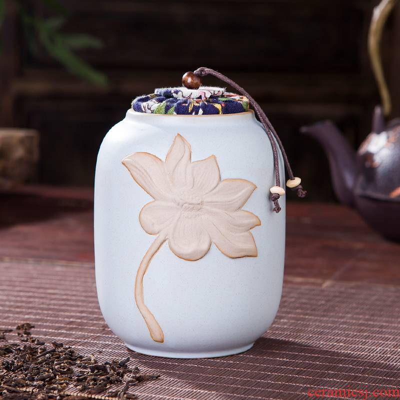 Jingdezhen embossed lotus checking ceramic tea caddy fixings warehouse sealed barrels of pu 'er tea to wake two POTS of cloth cover 4