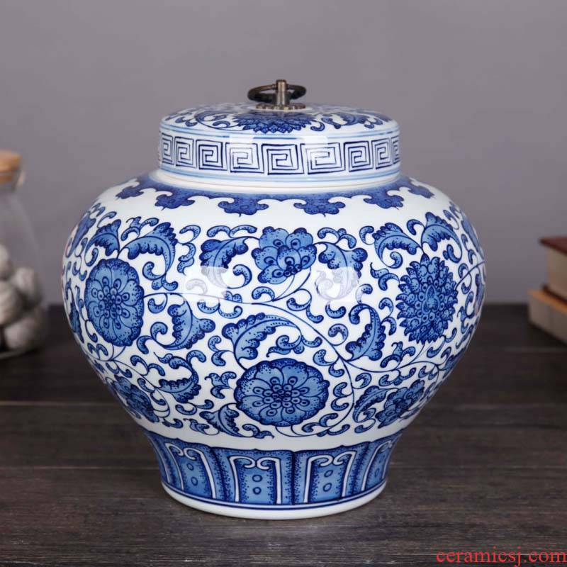 Jingdezhen ceramics pu 'er tea storage tank is blue and white porcelain lotus flower lohan pot home furnishing articles