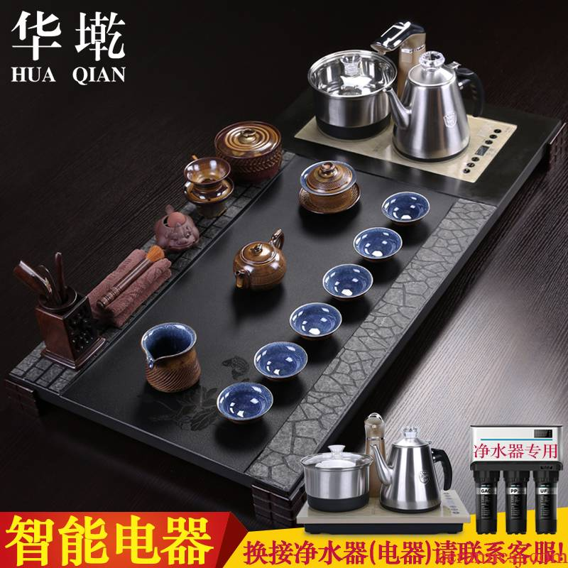 China Qian sharply stone kung fu tea set the whole grey or black gold stone tea tea table four unity of electric heating furnace
