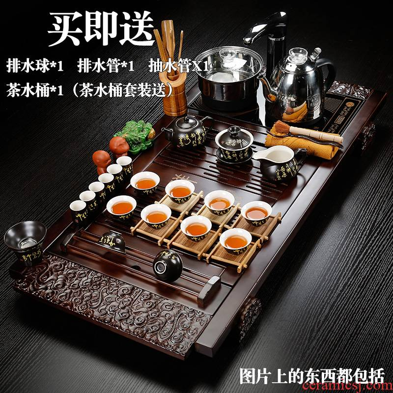 Back on solid wood tea tray was four unity of household ceramic kung fu tea set of a complete set of automatic tea set