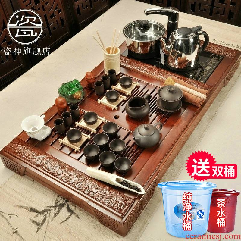 Kung fu tea set porcelain god set a complete set of tea cups of household solid wood tea tray tea sea magnetic electric furnace four unity