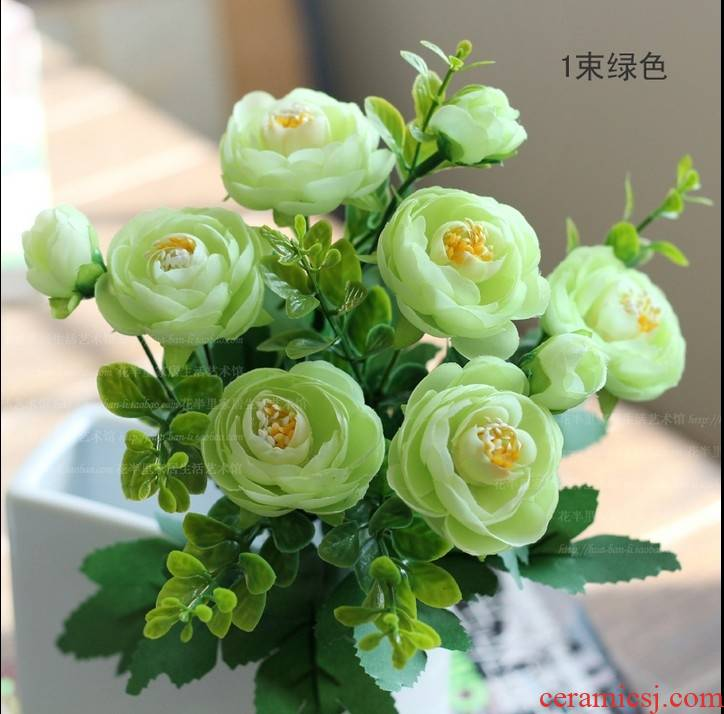 For the simulation of camellia single beam family flower arranging the sitting room the bedroom table cloth flowers, silk flowers, floral ornament