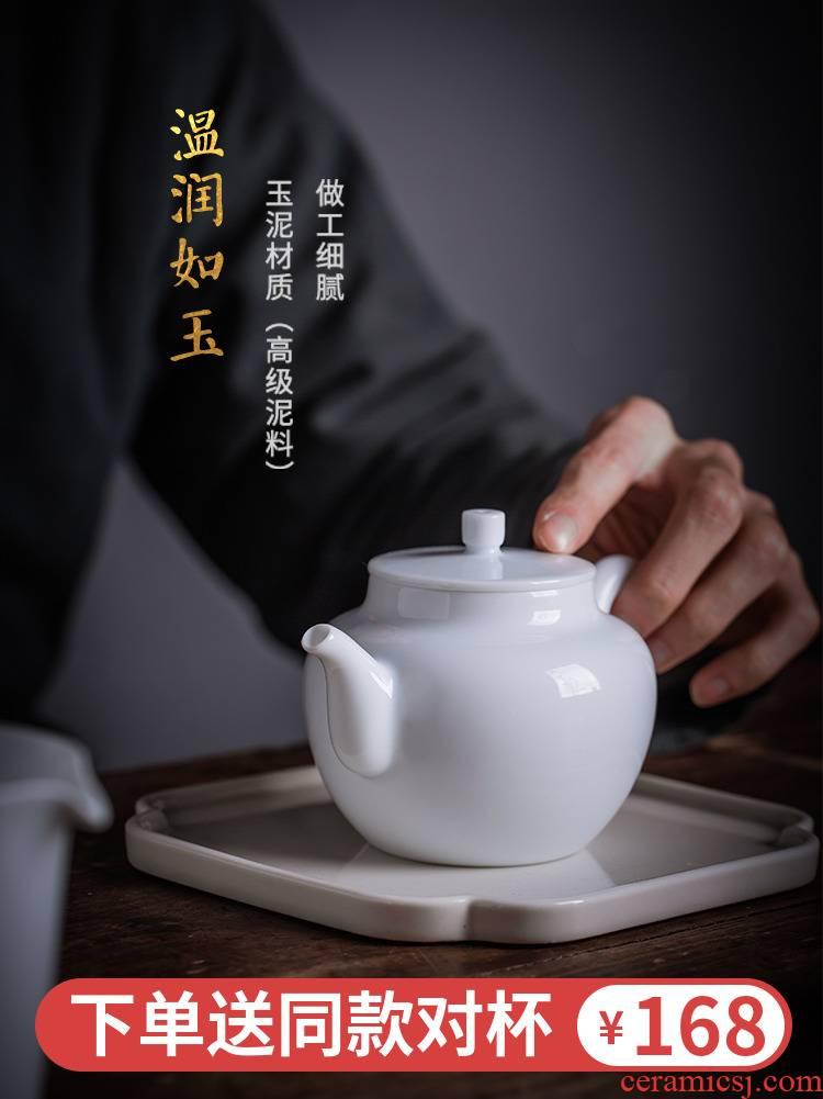 A person with A small white porcelain teapot single pot of jingdezhen ceramic tea set of the filter ball hole single large tea set