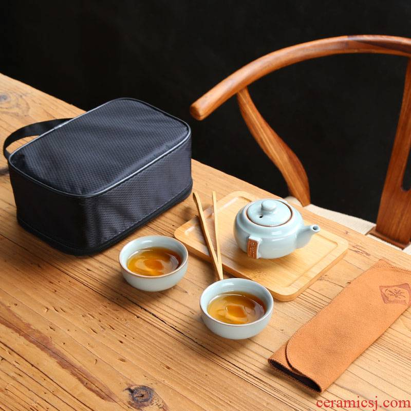 Travel tea set purple sand cup to crack a pot of two cups of portable package with kung fu tea cup trill the teapot