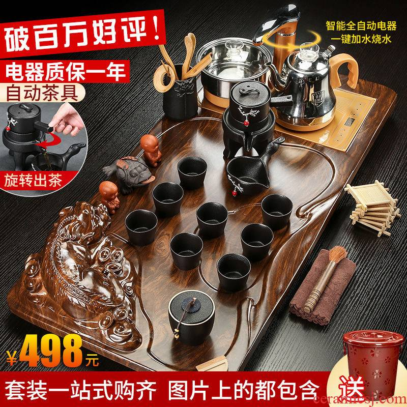A complete set of violet arenaceous kung fu tea tea cup automatic appliances solid wood tea tray tea set home