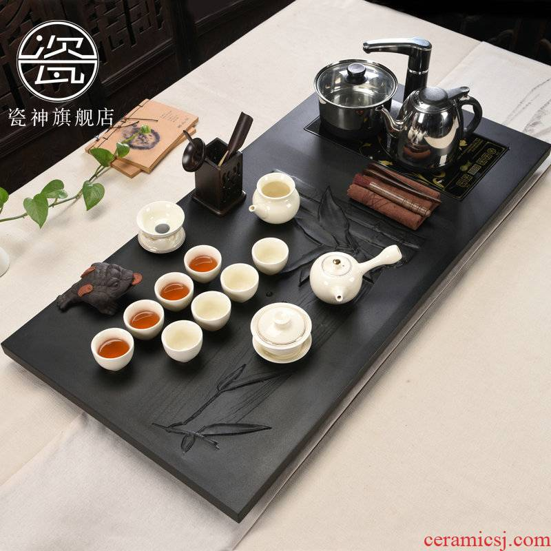 Porcelain god black stone tea suit household ceramic tea sets tea sea induction cooker sharply large stone, stone tea tray