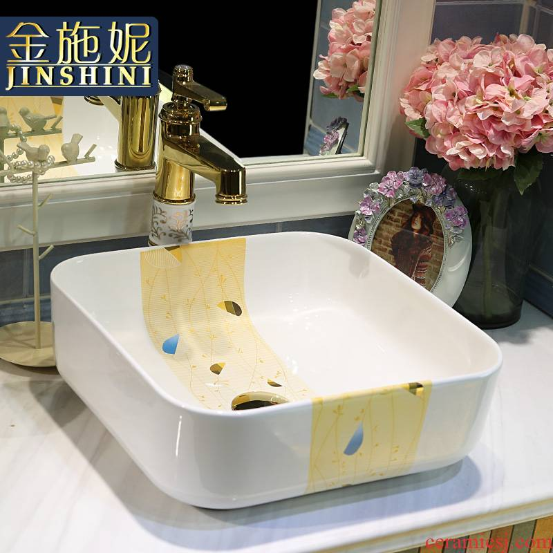 Gold cellnique square on the sink water basin European household ceramics washs a face of the basin that wash a face plate of one meter sunshine
