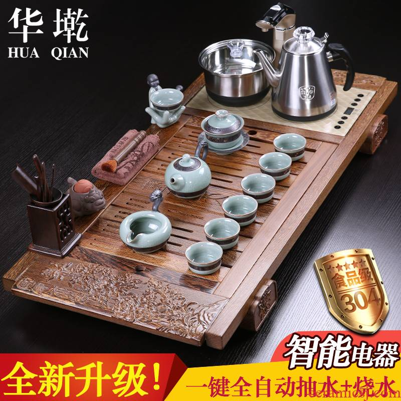 China Qian tea set chicken wings wood four unity induction cooker yixing purple sand tea tray was kung fu tea set automatic stone mill