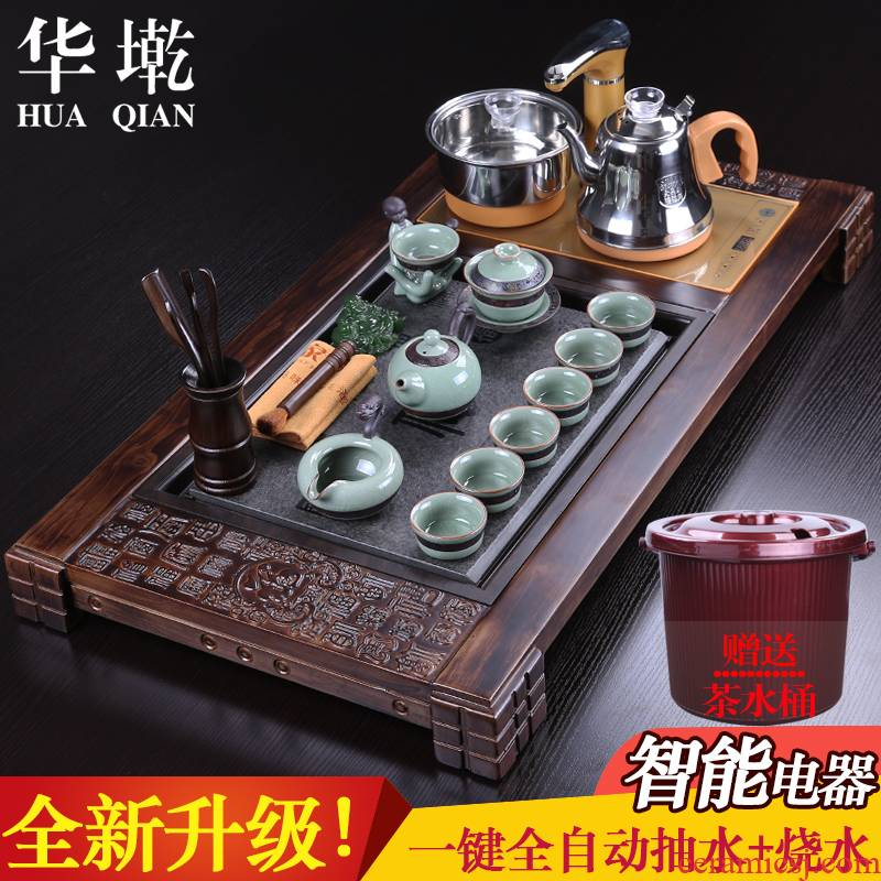 China Qian yixing purple sand kung fu tea set tea taking of household solid wood tea tray was four elder brother up and automatic water heating furnace
