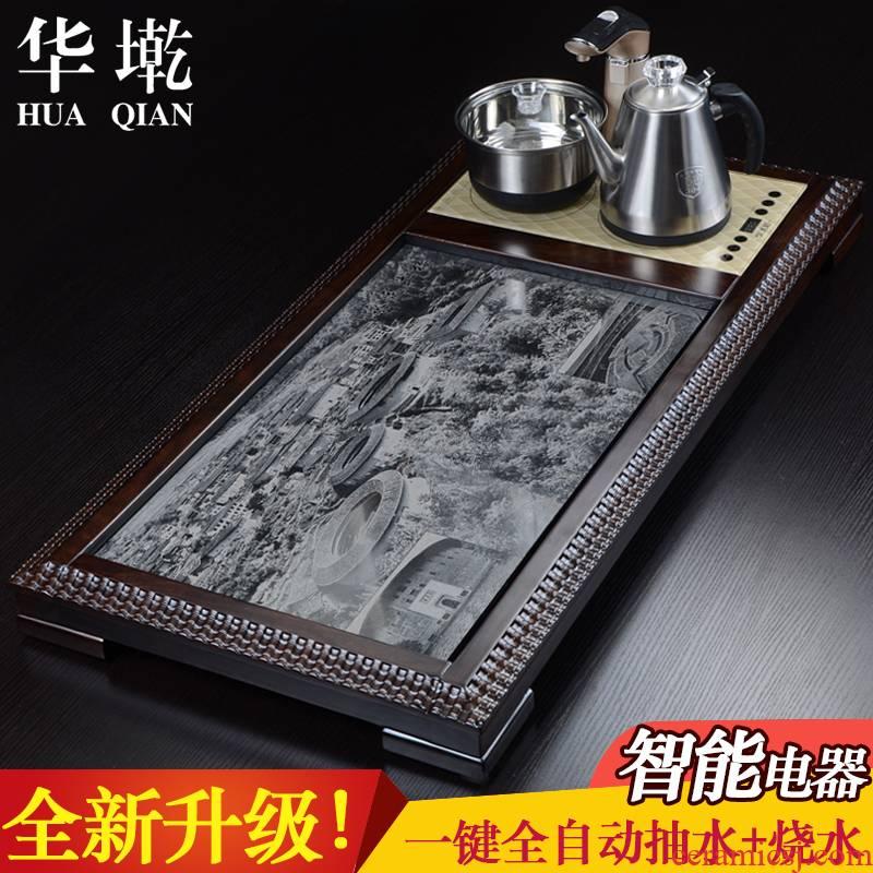 China Qian kung fu tea natural ebony wood tea tray was sharply stone large tea saucer sea four unity induction cooker