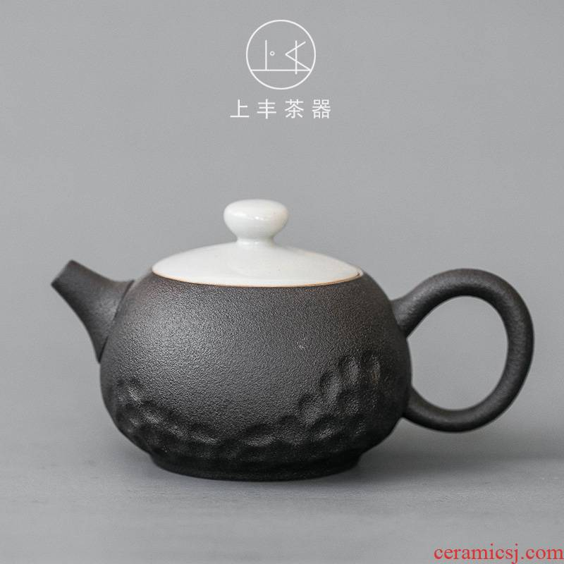 An Abundant ceramic black pottery teapot on Japanese traditional old - fashioned frosted trumpet dehua restoring ancient ways with handles small single pot