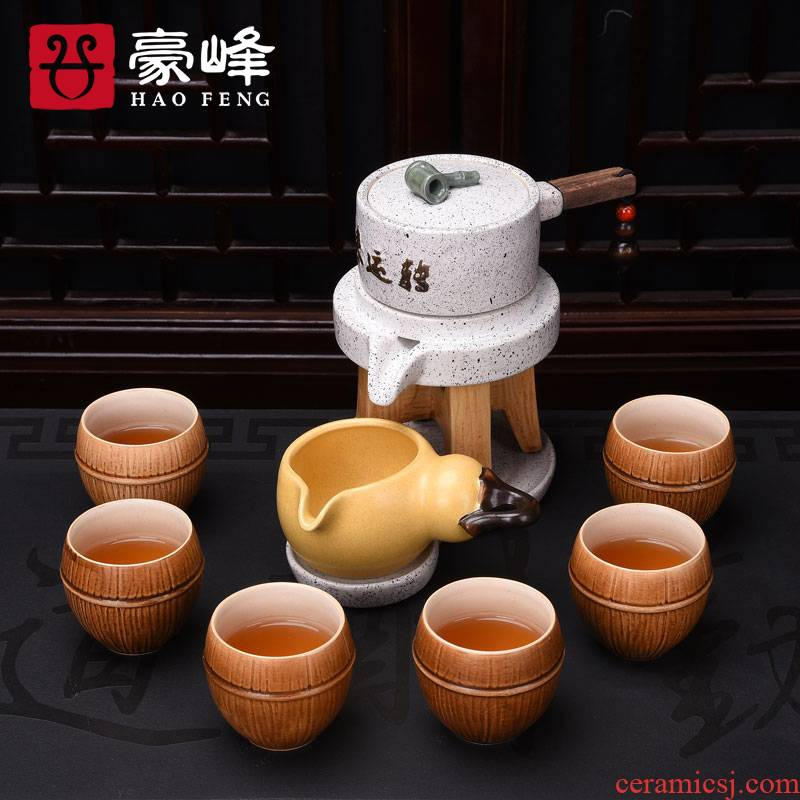HaoFeng creative lazy stoneware kung fu tea set stone mill automatically restore ancient ways of a complete set of Japanese teapot cup suit