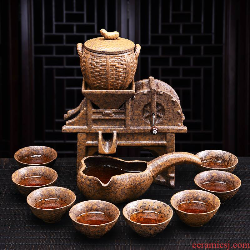 A complete set of creative lazy automatic ceramic kung fu tea set, the household of Chinese style restoring ancient ways millstones teapot cup suits for