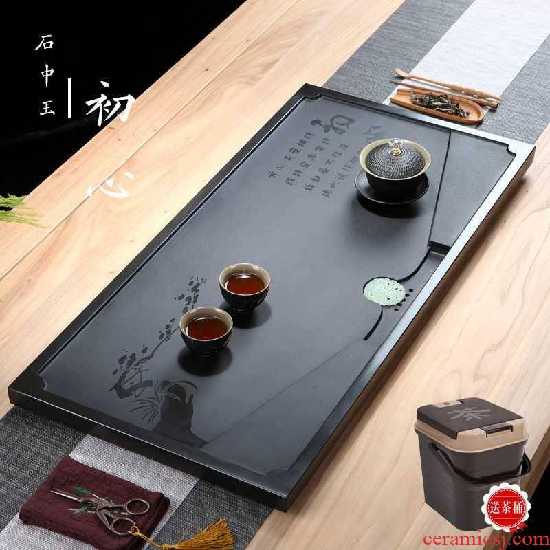 Chinese high - grade stone tea tray was sharply home natural block stone is black stone tea sets of kung fu tea set office