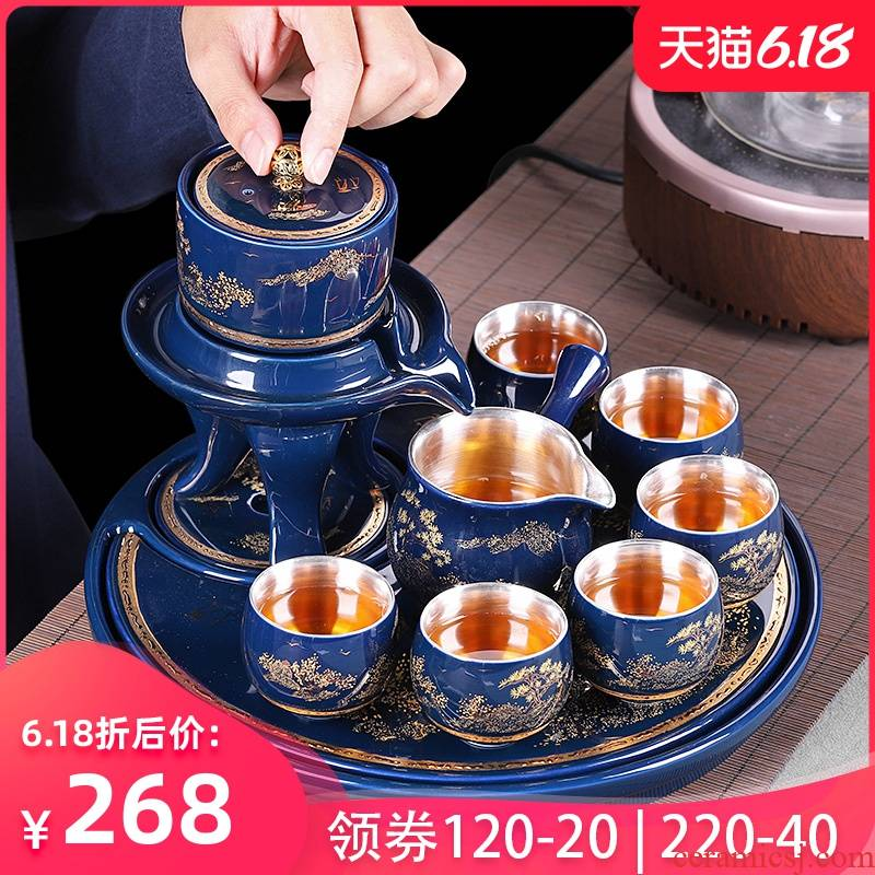 Jingdezhen kung fu tea set tea tray was stone mill rotating lazy automatic water ji blue office receives a visitor make tea