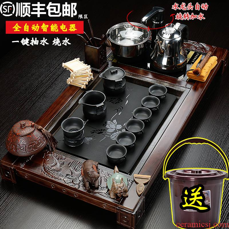 The sea make electric joining together of four solid wood automatic tea tray was purple sand tea set ceramic whole household kung fu tea taking