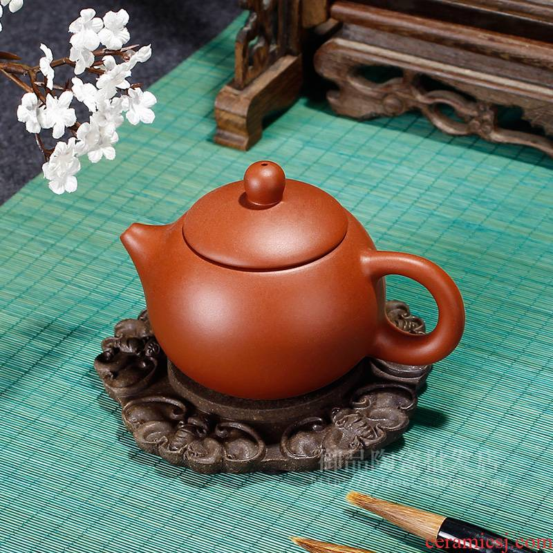 T a pot of purple sand up chunks of tea saucer of mat fills up the teapot mat pot pot bearing base bearing insulation pad the teapot