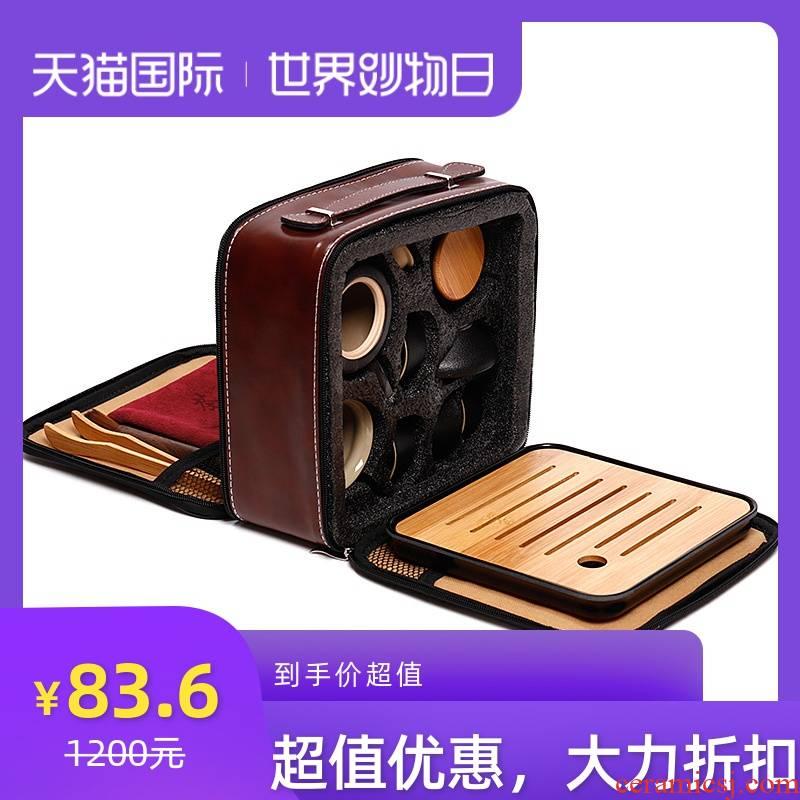 Japanese kung fu travel tea sets suit portable bag is suing black ceramic teapot tea art a pot of four cups of customization
