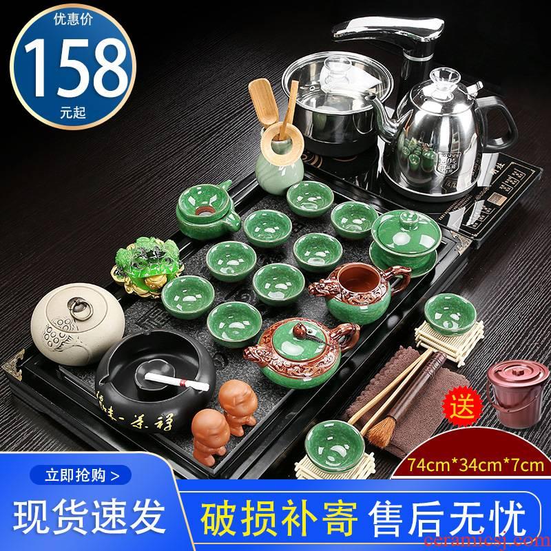 Ceramic purple kung fu tea set home sitting room solid wood tea tray tea tea sea of a complete set of automatic integration