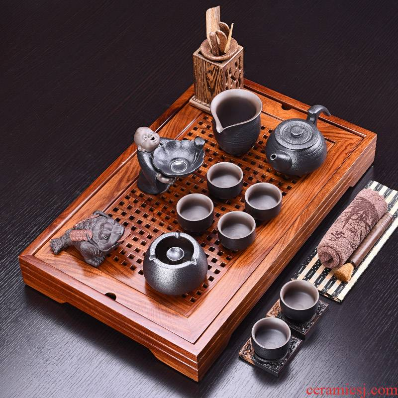 A complete set of kung fu tea set purple sand pottery and porcelain tea sets hua limu tea sets tea tea tray was solid wood tray