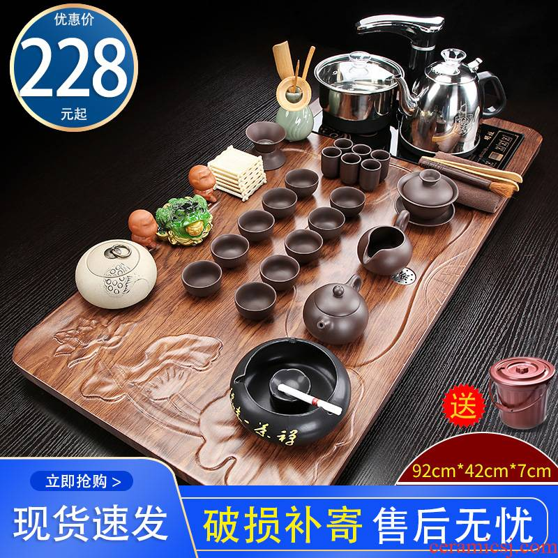 Automatic kung fu tea set with violet arenaceous contracted solid wood tea tray, making tea cups of a complete set of the tea taking
