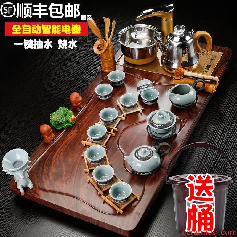 Sea leap of a complete set of violet arenaceous kung fu tea set suit household automatic four unity simplicity teapot tea tray