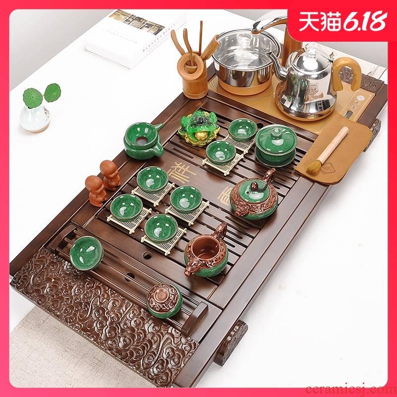 Automatic tea set household purple sand pottery and porcelain of a complete set of kung fu tea set solid wood tea tray tea four unity