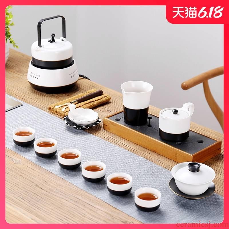 Sand embellish pottery sides kung fu tea set simple black and white porcelain paint TaoLu ceramic teapot teacup of a complete set of electricity