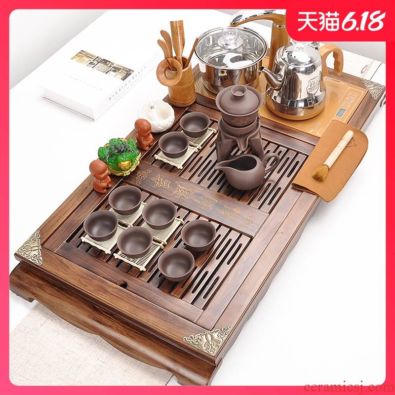 A complete set of automatic tea suit household violet arenaceous kung fu tea set four unity contracted solid wood tea tray was restoring ancient ways